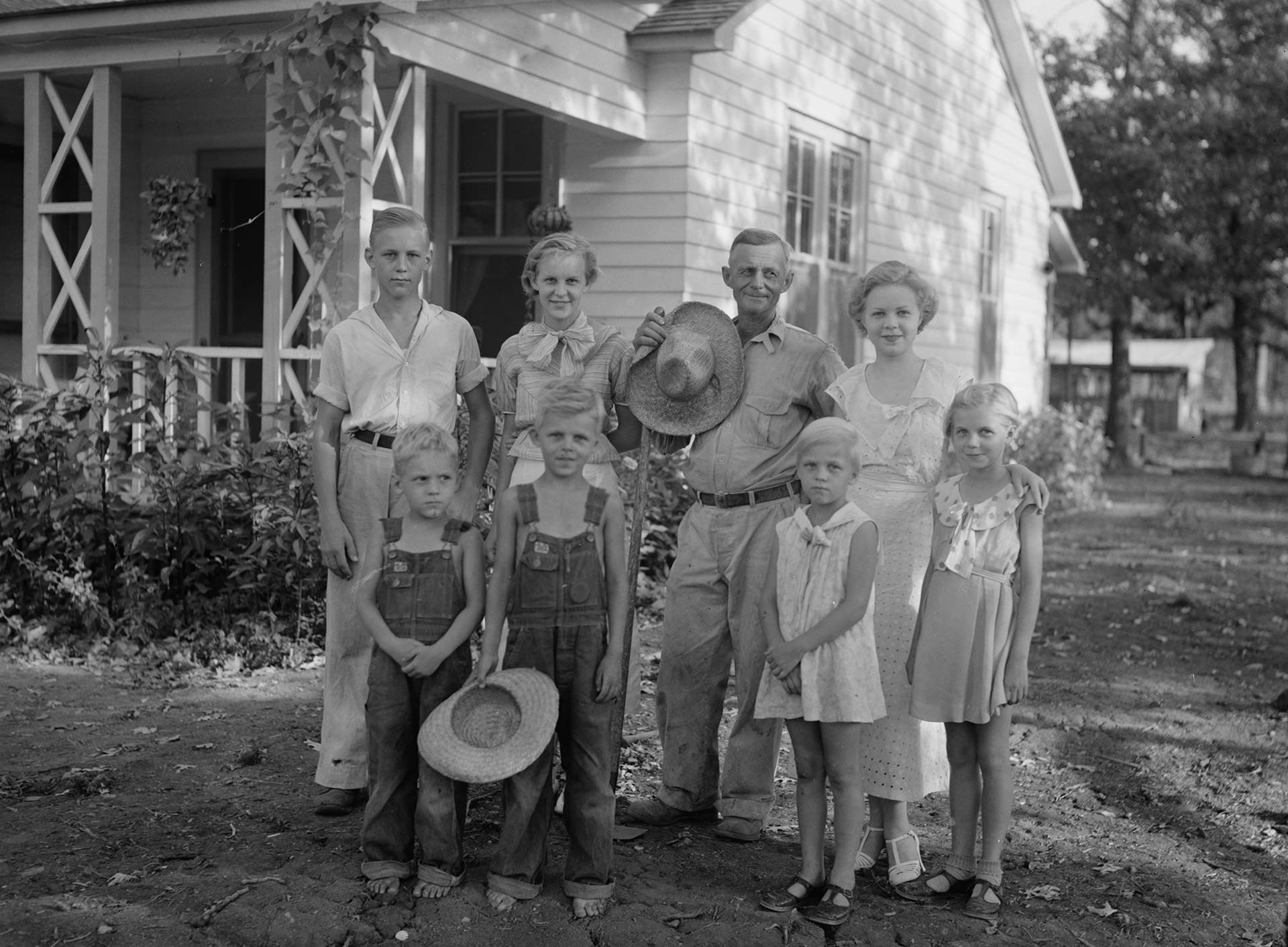 A resettled farmer and his family, photographed by Arthur Rothstein in 1935 at Dyess.
