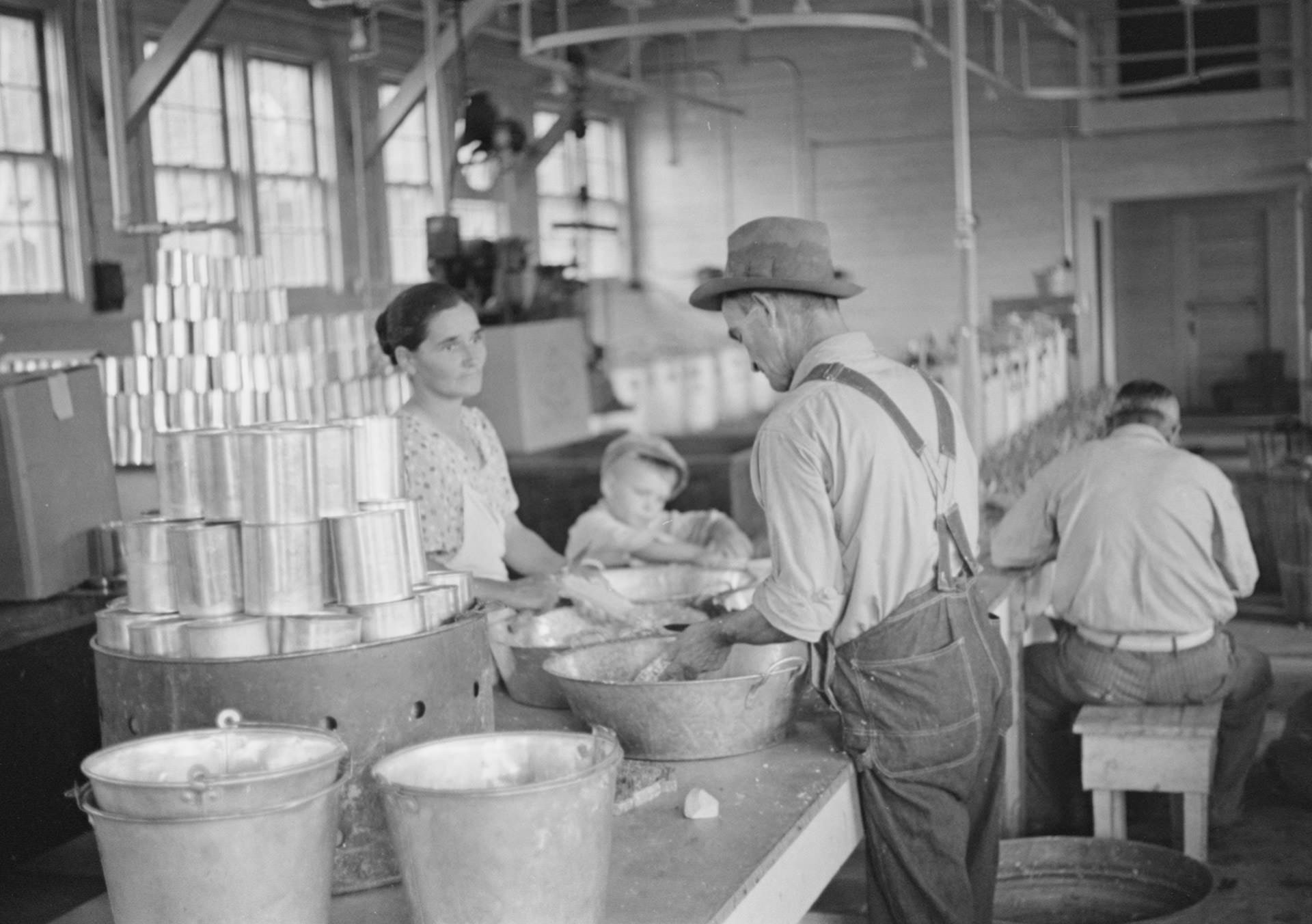 Dyess residents assist each other in a community canning workshop, photographed by Ben Shahn.