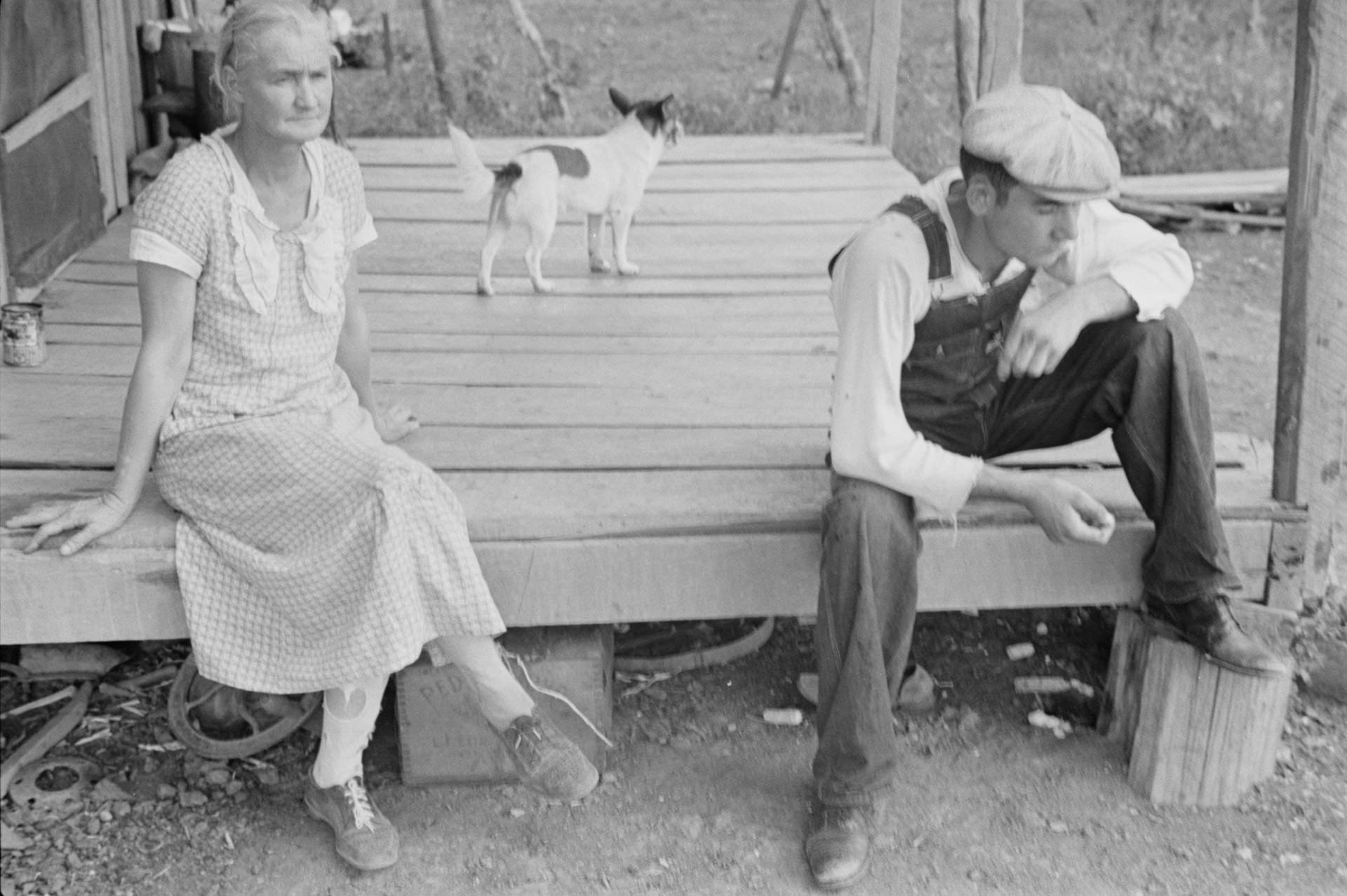 Sharecropper family members sit on their porch, photographed by Ben Shahn in 1935 at Dyess.
