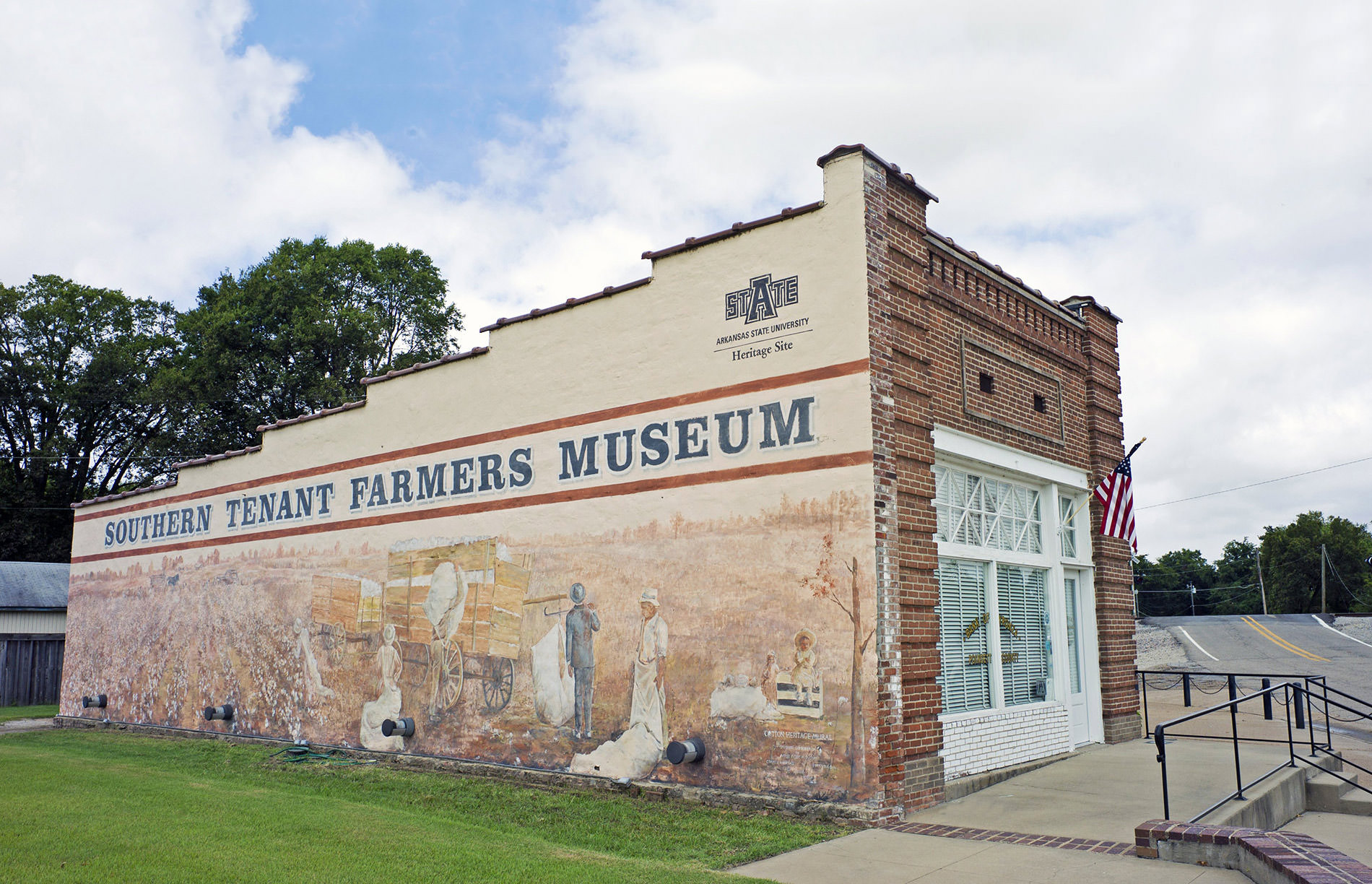 A mural depicting the cotton heritage of east Arkansas was painted on the south wall of the Southern Tenant Farmers Museum in Tyronza by Connie Watkins of Paragould.